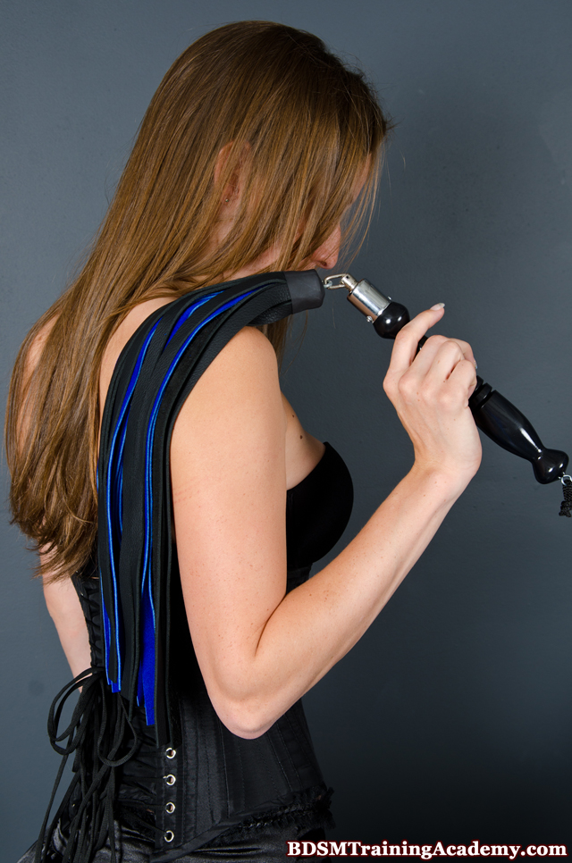 Advanced Swivel Flogger In Dominatrix Hand