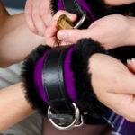 Locked Faux Fir Bondage Cuffs Close Up
